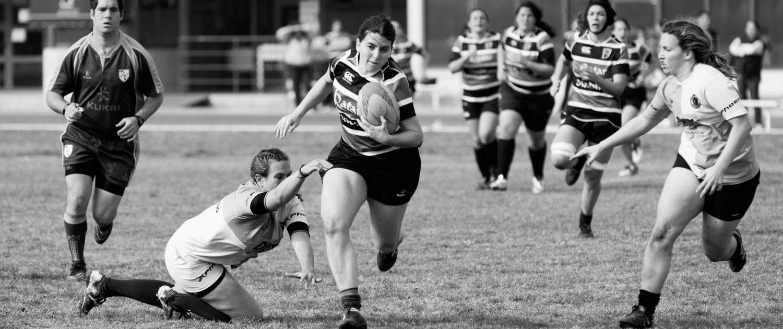Sportswomen on a rigby pitch