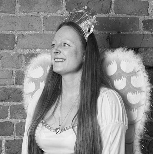 Torso shot of Jill Clifford wearing angel wings